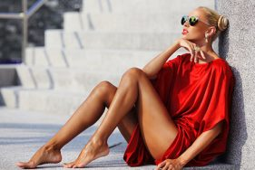 Blond escort sunbathing by the pool in Bonifacio