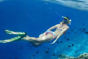 Escort girl dives for diamonds