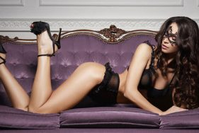 Escort in lingerie on the sofa