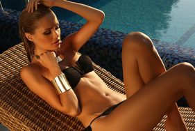 Escort girl relaxing by the pool on the Seabourn
