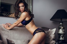Vienna Escort Girl in sexy lingerie on the sofa